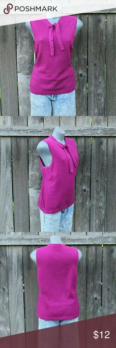 Banana Republic Sleeveless Tee, Attached Tie Lightweight knit.  Top is not lined.  Tie is attached to the neckline and can be tied into a very small bow.  Fabric has stretch.  Color is in the fuchsia family with red/pink undertone.    -Size (according to tag): XL -Label: Banana Republic -Chest circumference (armpit to armpit, laying flat): 40? -Sleeve opening: 12? -Length (top of shoulder seam to hem): 25 ?? -Sweep (laying flat): 21 ?? -Fabrication: 75% cotton 15% silk 10% Rayon -Care…