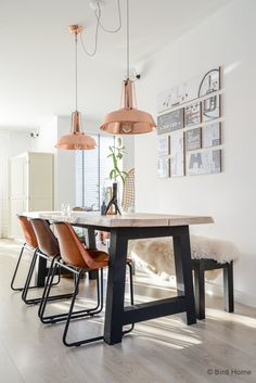 Industrial table & copper lamps. Love it!