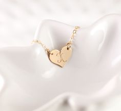 Our dainty initial gold heart necklace can be paired with any outfit! Makes the…