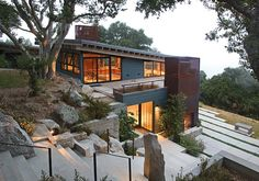 Built into the hillside, the home blends into the landscape.