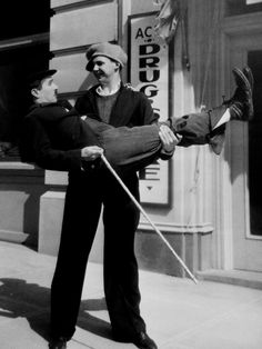 Jackie Coogan, former child star of The Kid now aged 20, visits Chaplin on the set of Modern Times (1935). Too sweet <3 :D