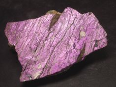 Purpurite / Erongo Region, Namibia  So lucky to have a bracelet with one bead of this stone - it's so rare to find.