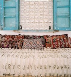 Printed pillows look like turkish rugs - gorgeous mix and match~love the wall hanging idea. Bohemian Style.