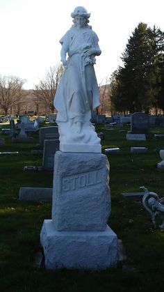 Angel statue overlooking the Stoll Family Stone