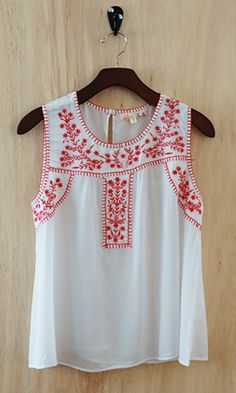 Add a bohemian feel to your outfit with this notched scoop neck blouse highlighted with an intricately hand embroidered bib front. Keep your...
