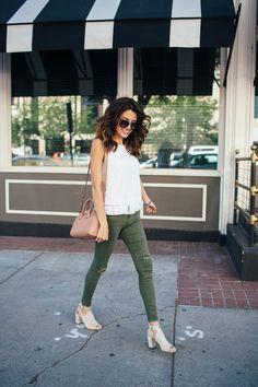 White fringe top + distressed pants.