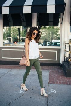 White fringe tank top + olive distressed jeans + nude mules