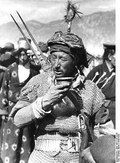 Tibetan warrior in chain-mail drinking tea, 1938 .