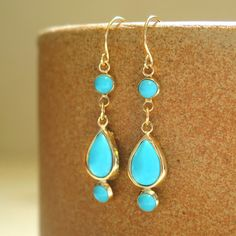 Hey, I found this really awesome Etsy listing at https://www.etsy.com/listing/478265923/dangle-turquoise-earrings-14k-gold