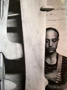 Isamu Noguchi in his studio at 33 MacDougal Alley New York City July 4, 1947 (photo Arnold Newman) View of the studio courtyard. c.1940s (p...