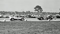 Al Bochroch captures a Shelby Cobra Daytona Coupe being overtaken by the winning Chaparral during the 1965 Sebring 12 hours.