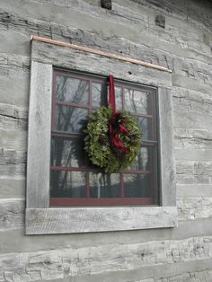 A SINGLE WINDOW. The chinking is not done properly, the top should dip in an inch, and the bottom flush, so the water runs off. On the inside of a log cabin the chinking is flush with the logs.