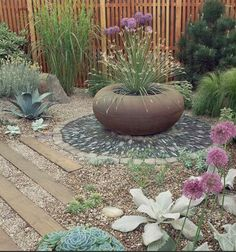 Pretty plants/texture contrast.  Dry Garden    Live in a dry area? Consider using gravel rather than lawn grass that requires lots of water and plants that thrive in arid conditions.