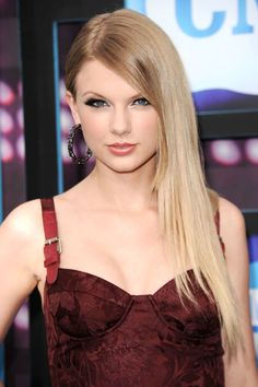 Swift changes things up with slick-straight locks at the CMT Music Awards.   - HarpersBAZAAR.com
