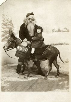 vintagephoto:  very confused by this one. zombie Santa by donkey? From Shrek?