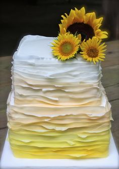 Sunflower cake  I'd change the colors and make it apply to a winter wedding style