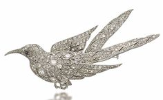 AN ART DECO DIAMOND BROOCH, BY VAN CLEEF & ARPELS   Modelled as a bird, set with rose and circular-cut diamonds, 1927, 6.0 cm, with French assay mark for platinum  By Van Cleef & Arpels, no. 29062