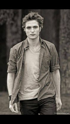Edward Cullen from the Twilight movie series Edward Cullen Photo enhancement by Melbie Toast Twilight Saga Series, Twilight Edward, Edward Bella, Twilight New Moon, Twilight Series, Twilight Movie, Twilight Poster, Edward Cullen Robert Pattinson, Robert Pattinson Twilight