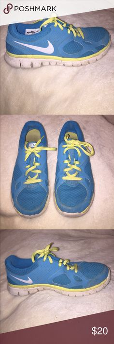 Nike tennis shoes Cute blue and yellow tennis shoes. A little bit dirty but otherwise in great shape. No holes or rips! Nike Shoes Athletic Shoes