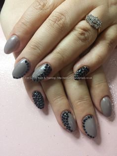 Country club nude gel polish with black stone nail art