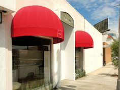 Attention-getting, bright red dome awnings by Superior Awning in Southern California superiorawning.com