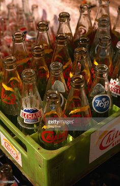 Stock Photo : A crate of empty soft drink bottles in Panaji