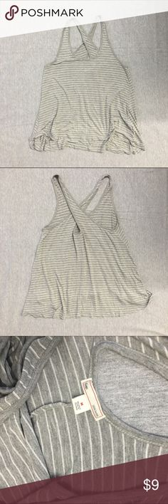Gap cross cross knit tank Loose fitting, stretchy knit. Stripes. Almost has a shark bite cut to it when it is worn. GAP Tops Tank Tops