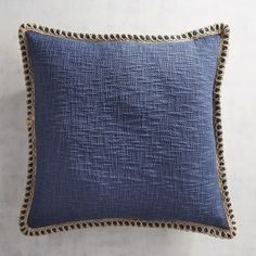 Comfort and style combine in our jute-trimmed cotton pillow. Soft to the touch with nice loft and a pleasing navy hue, it will maintain its simple good looks for many seasons to come.