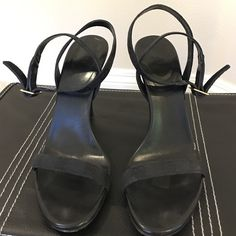 """GUCCI black strappy sandals Sexy GUCCI black strappy sandals, gently worn and in great condition. Heels measure approx. 4"""".  Gucci logo on fabric surface with gold slide buckle closures.  In excellent pre-owned condition. Please ask any questions you may have before purchasing. 🚫Trades, 🚫Low ball offers please. Gucci Shoes Sandals"""