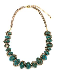 Go utterly elegant with this can't-miss-it statement necklace. It flaunts a bevy of oversized speckled turquoise stones and silver chain links woven in for a truly stunning style.