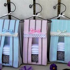 These handmade diaper stacker sachets are the perfect baby shower favor. Hang these adorable sachets on doorknobs, in closets or on drawer pulls by their hand-wrought iron hangers. Sachets measures x and is custom made by a European artist. Baby Shower Favors, Baby Shower Parties, Baby Shower Gifts, Shower Party, Baby Showers, Diaper Holder, Diaper Organization, Diaper Parties, Baby Crafts