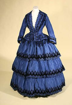 Two-piece blue silk taffeta dress with black velvet, decorated with black chenille, black wooden beads and black ribbon loop England, circa 1855