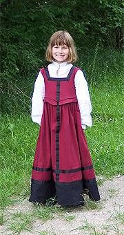 by Philippa Montague.  3 years later the hem of the original dress was let down and guards attached, making the costume last longer, since kids generally grow up rather than out
