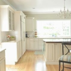 Benjamin Moore Camouflage is a subtle green paint colour with warm gray undertones. Shown in this white kitchen by Centsational Girl