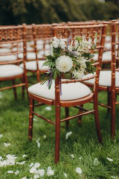 ceremony chair with flowers - photo by Paula O'Hara http://ruffledblog.com/art-nouveau-irish-mansion-wedding