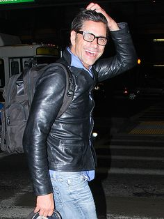 From his fitted leather jacket to his chunky black rectangular specs, John Stamos was the epitome of badass chic!