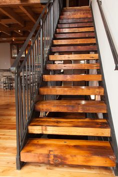 chunky wooden steps with steel sides and black ballustrade