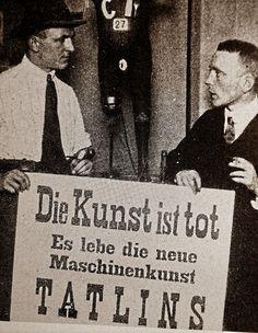 George Grosz & John Heartfield holding placard    'Art is Dead – Long Live Tatlin's Machine Art',