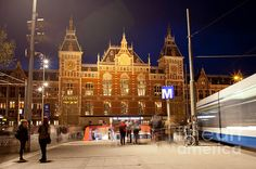 Amsterdam Central Train Station and metro entrance at night in Holland, Netherlands.
