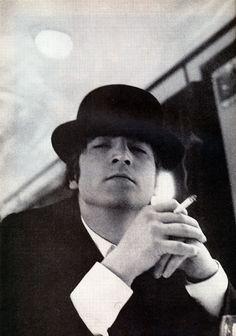 John Lennon. Photo by Astrid Kirchherr. Just love his cockiness here!