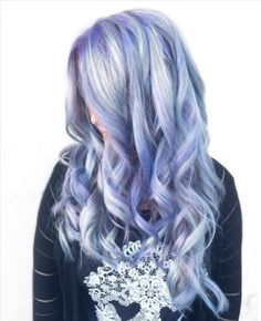 Go big or go home with holographic hair, the latest holo trend taking Instagram and Pinterest by storm. #purple #holographic #rainbow #hairstyle