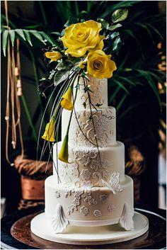 white wedding cake with yellow flowers