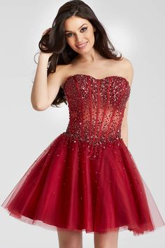 898683accd4 Fit and flare tone on tone beaded short burgundy dress features strapless  sheer corset bodice with sweetheart neckline.