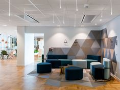 pS Arkitektur has developed a modern and vibrant office design for pest control company, Anticimex, located in Stockholm, Sweden. Modern Office Design, Office Interior Design, Office Designs, Corporate Interiors, Office Interiors, Salas Lounge, Grey Interior Doors, Office Lounge, Office Reception Design