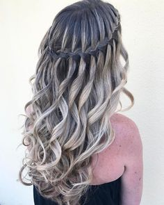 Curly Hairstyle With Waterfall Braid