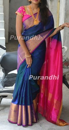 Beautiful blue color designer saree and pink color designer blouse. Blouse with hand embroidery kundan and pearl work.   30 August 2018