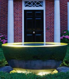 Chalice stainless steel water feature light up at dusk