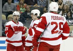 CrowdCam Hot Shot: Detroit Red Wings center Tomas Tatar celebrates after scoring a goal along with teammates defenseman Adam Almqvist and center Landon Ferraro against the Pittsburgh Penguins during the first period at the CONSOL Energy Center. Photo by Charles LeClaire