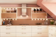 Colored with light colors like peach walls and cream-colored cabinets, this kitchen looks subtle yet classy.