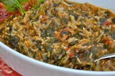 This spinach and rice pilaf known as Spanakorizo (spah-nah-KOH-ree-zoh) is a simple and easy dish made with spinach, tomatoes and fresh dill. A great pilaf on it's own, as a side dish, or as a meatless stuffing for vegetables.